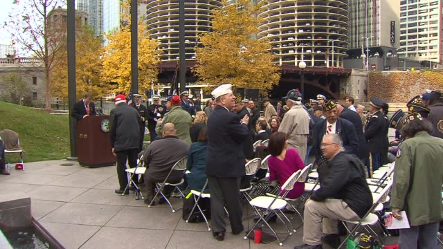 crowd at vietnam veterans memorial ceremony on veteran's day on november 10, 2012 in chicago, illinois - veterans day stock videos & royalty-free footage