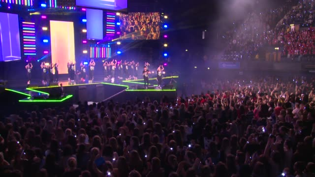 crowd atmosphere at we day uk at wembley arena on march 7, 2014 in london, england. - wembley arena stock videos & royalty-free footage