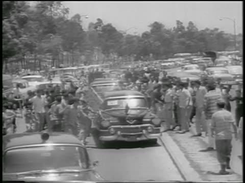 crowd attacking nixon's motorcade / venezuela / newsreel - 1958 stock videos & royalty-free footage