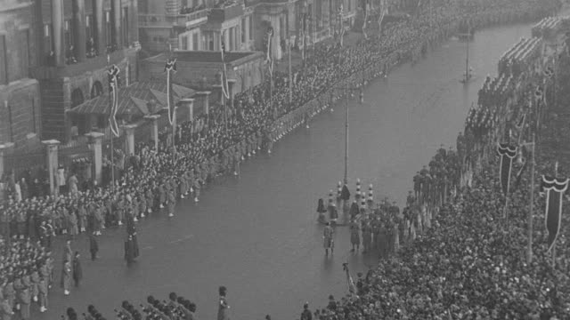 a crowd attends the funeral procession for king george v at hyde park in london, england. - military parade stock videos & royalty-free footage