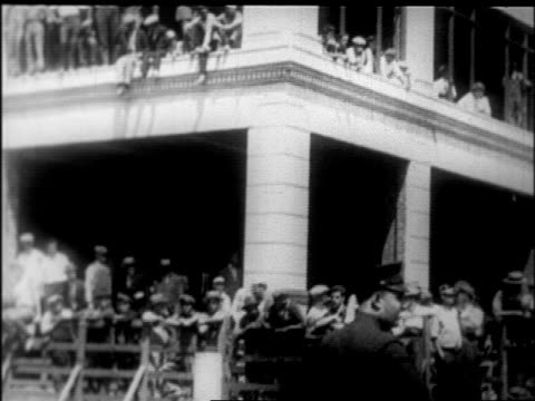 b/w 1926 crowd behind barricade at rudolph valentino's funeral procession / nyc / newsreel - 1926 stock videos & royalty-free footage
