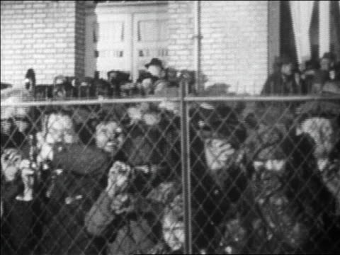 b/w 1927 crowd behind fence at le bourget airfield in paris to greet lindbergh / newsreel - crisscross stock videos & royalty-free footage