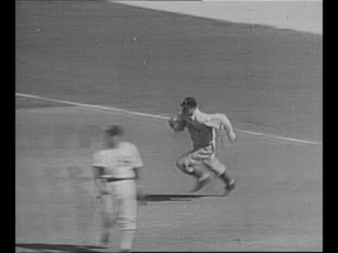 crowd behind stadium screen at baseball game / CU New York Yankees player Joe DiMaggio at bat during his rookie year / montage rookie DiMaggio gets a...