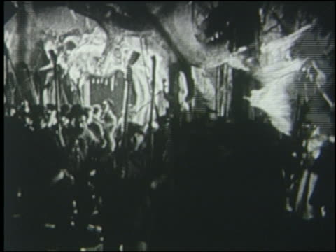 b/w 1925 crowd carrying torches running in sewer - flaming torch stock videos & royalty-free footage
