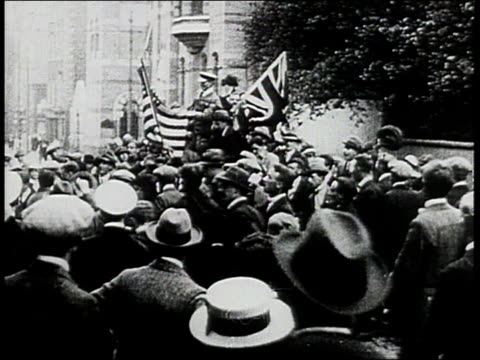 vidéos et rushes de crowd celebrating arthur whitten brown and john alcock making the world's first nonstop transatlantic flight / england - 1910 1919