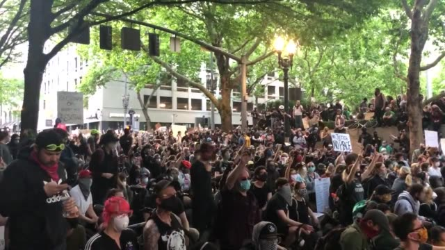 "crowd chants ""we want change"" at our peaceful protest in portland oregon a peaceful protest for george floyd in portland oregon - portland oregon stock videos & royalty-free footage"