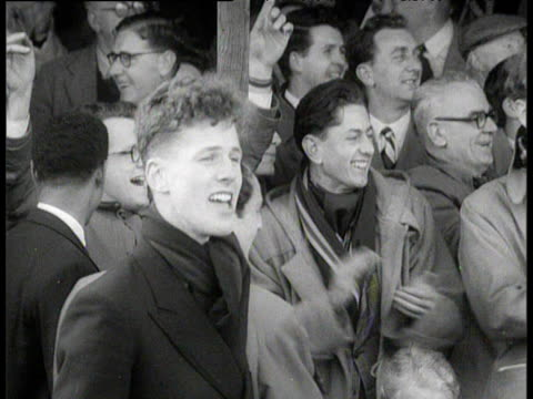 Crowd cheer and applaud Roger Bannister's efforts as he becomes first man to break sub four minute mile Iffley Road oxford 6 May 1954