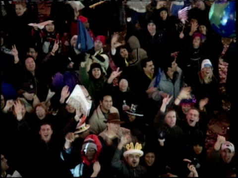 crowd cheering and waving in times square for 1999 new year's eve celebration - 1999 stock videos & royalty-free footage