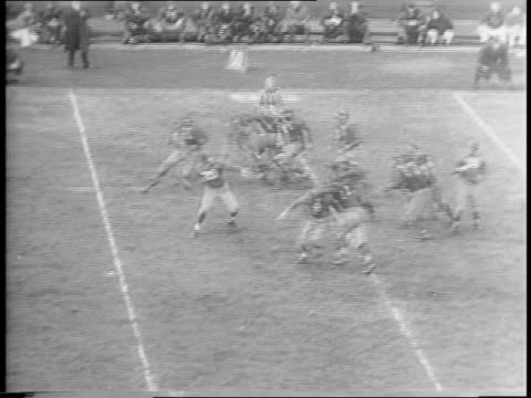 crowd cheering / arnie herber passes to frank liebel and he scores touchdown / cheering crowd / redskin frank filchock goes to pass but breaks free... - nfc east stock videos & royalty-free footage