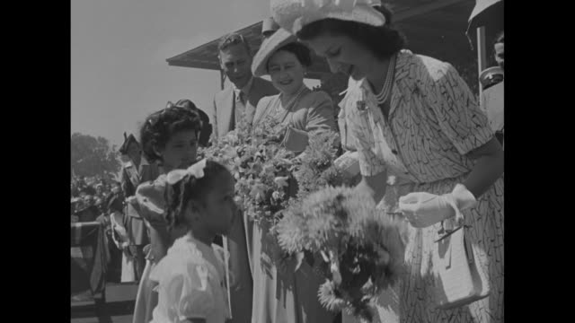 crowd cheering as car with george vi queen mother elizabeth princess margaret princess elizabeth drives on the cricket fields of st george's park in... - 1947 stock videos & royalty-free footage