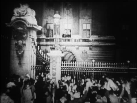 b/w 1938 crowd cheering at gates of buckingham palace / prime minister royalty on balcony in background - 1938 stock videos and b-roll footage
