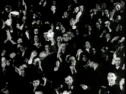 stockvideo's en b-roll-footage met crowd cheering. newly elected president franklin d. roosevelt 'fdr' standing at building entrance w/ cane & assistant, waving. - 1933