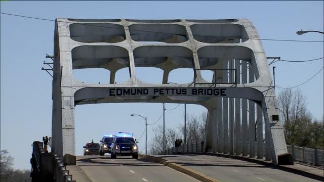 crowd cheers as presidential motorcade crosses historic pettus bridge on march 7 2015 in selma alabama - 2015 stock videos & royalty-free footage