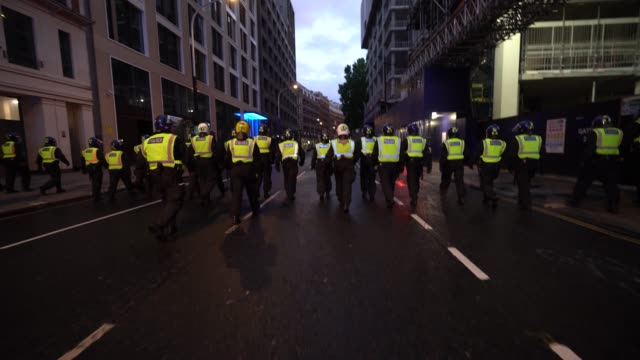 crowd control police officers push back aggressive protesters after a black lives matter march through central london on june 6 2020 in london united... - aggression stock videos & royalty-free footage