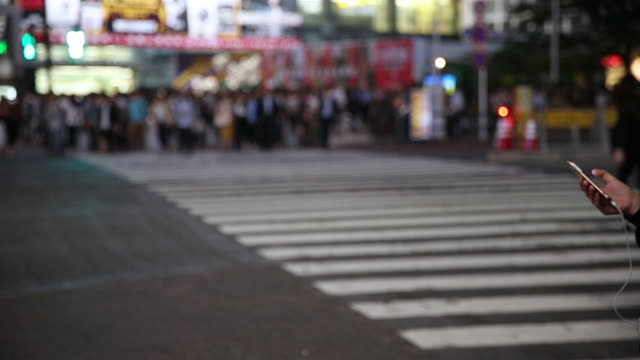 crowd crossing city road while raining - zebra crossing stock videos & royalty-free footage
