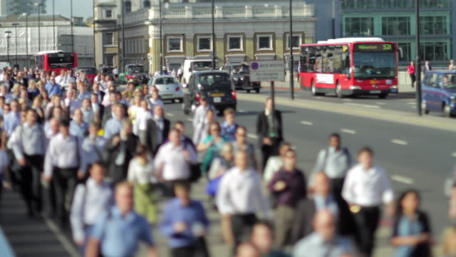 ws selective focus crowd crossing london bridge / london, united kingdom - london bridge england stock videos and b-roll footage