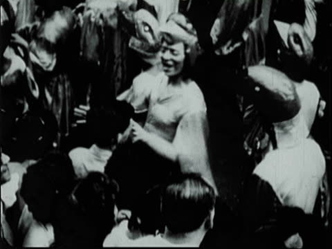 montage crowd dancing and celebrating on the streets during carnival / south america - 1951年点の映像素材/bロール
