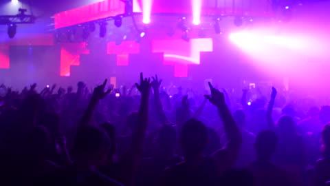 crowd dancing at remembrance festival, wide shot - nattklubb bildbanksvideor och videomaterial från bakom kulisserna