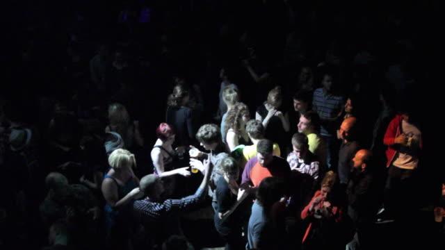 ws ha crowd dancing in nightclub / london, united kingdom - dance floor stock videos & royalty-free footage