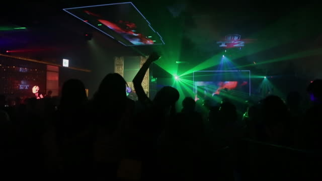 crowd dancing in tokyo nightclub, wide shot - nightclub stock videos & royalty-free footage