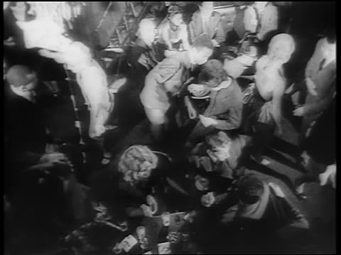 B/W 1961 OVERHEAD crowd dancing the Twist on dance floor / newsreel