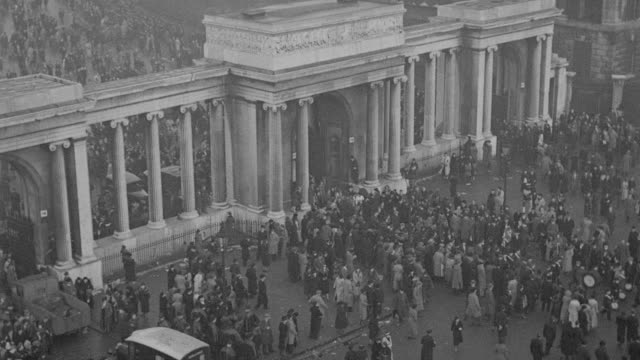 a crowd disperses from hyde park following the funeral procession of king george v. - british royalty stock videos & royalty-free footage