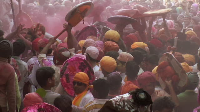 ms td crowd enjoying lath mar holi, barsana / mathura, uttar pradesh, india - human limb stock videos & royalty-free footage