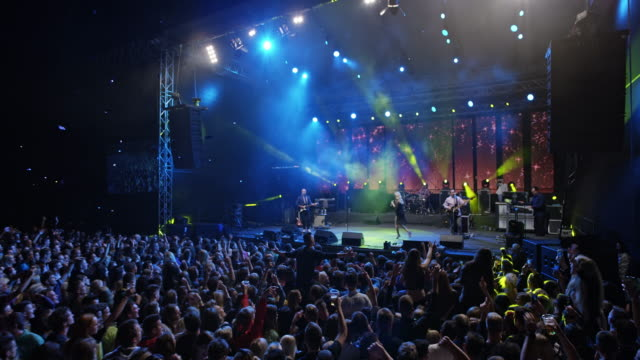 cs crowd enjoying performance by female singer on stage - stage light stock videos & royalty-free footage