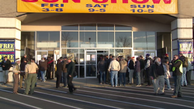 crowd enters and exits the building at the nation's gun show at the dulles expo center on december 28, 2012 in dulles, virginia - アメリカ憲法点の映像素材/bロール