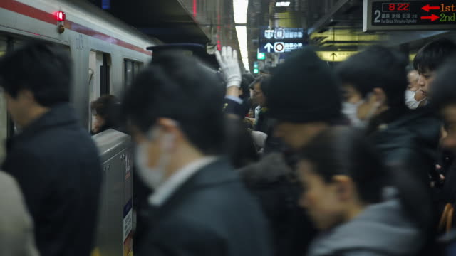 crowd enters subway at rush hour - tokyo, japan - beengt stock-videos und b-roll-filmmaterial