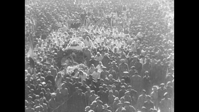 crowd following body of mahatma gandhi body of gandhi surrounded by flowers funeral pyre being started ha behind prime minister jawaharlal nehru... - 1948 stock videos & royalty-free footage