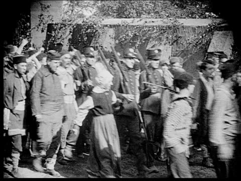 1916 b/w crowd following soldiers down street with raised fists - 1916 stock videos & royalty-free footage