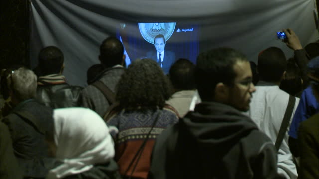 ms crowd gathered around a screen in tahrir square and watching murbarak's speech / cairo egypt - 2011 stock videos & royalty-free footage