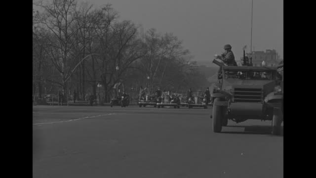 crowd gathered around ornate posts at east side of capitol building / lines of motorcycles in formation with armored vehicle with anti-aircraft gun... - 大統領就任式点の映像素材/bロール