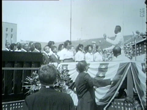 wgn crowd gathered at soldier field june 21 1964 for the illinois i have a dream civil rights rally school children in a choir walking in a line on... - segregation stock videos & royalty-free footage