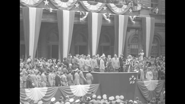 crowd gathered in front of speaker's platform in square in front of new york city hall / two close views of women in crowd / close view of... - allied forces stock videos and b-roll footage