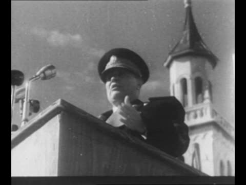 stockvideo's en b-roll-footage met crowd gathered in square in split, croatia, to hear marshal josip tito as he campaigns here during tour of the country / tito speaks from balcony,... - kerktoren