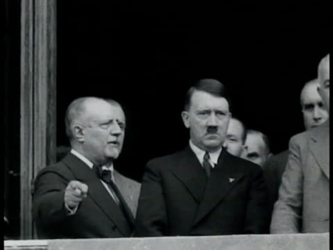 crowd gathered in square waving italian fascist dictator benito mussolini in uniform on balcony w/ hitler in suit standing serious giving slight hand... - benito mussolini stock videos & royalty-free footage