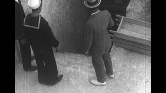 crowd gathered near king tut's tomb in the valley of the kings in egypt / us navy sailor poses near door to tomb / rear shot... - tomb stock videos & royalty-free footage