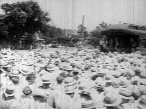 pan crowd gathered near train caboose to hear hoover speak during campaign / newsreel - 1928 stock-videos und b-roll-filmmaterial