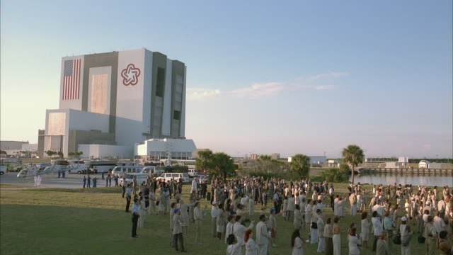 ws ha pan crowd gathered outside space center looking at countdown clock - 1997 stock videos & royalty-free footage