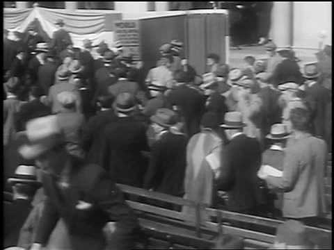 b/w 1933 crowd gathering at huge book / petition for world peace / union square nyc / newsreel - 1933 stock videos & royalty-free footage