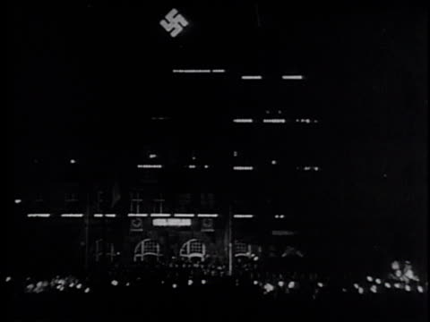 crowd gathering for adolf hitler / crowd cheering / swastika flags dipping in unison / adolf hitler paul von hindenburg and other men standing in... - nazi germany stock videos and b-roll footage