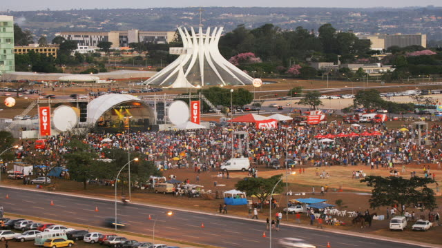 T/L, HA, WS, Crowd gathering in front of outdoor concert stage  at Metropolitan Cathedral, day to night, Brasilia, Brazil