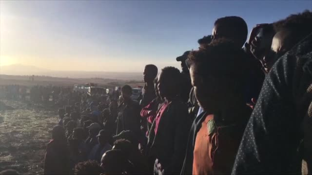 a crowd gathers at the crash site of the ethiopian airlines boeing 737 near bishoftu a town some 60 kilometres southeast of addis ababa ethiopia - ethiopia stock videos & royalty-free footage