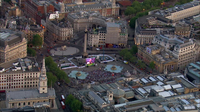a crowd gathers below nelson's column in london's trafalgar square. - nelson's column stock videos and b-roll footage