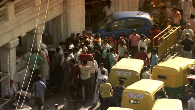 a crowd gathers on a busy delhi street. - delhi stock videos & royalty-free footage