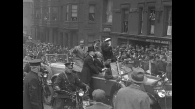 crowd greeting pilots at train station / boston mayor malcolm e nichols shaking hands with irish pilot james fitzmaurice with german pilot ehrenfried... - massachusetts stock videos & royalty-free footage