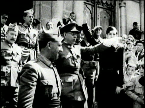 a crowd hails spanish general francisco franco as he leaves a building - spain stock videos & royalty-free footage