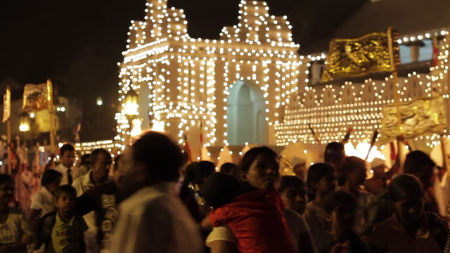 ms crowd heads home in front of temple of tooth after buddhist procession 'esala perahera' has finished / kandy, central province, sri lanka - sri lankan culture stock videos and b-roll footage